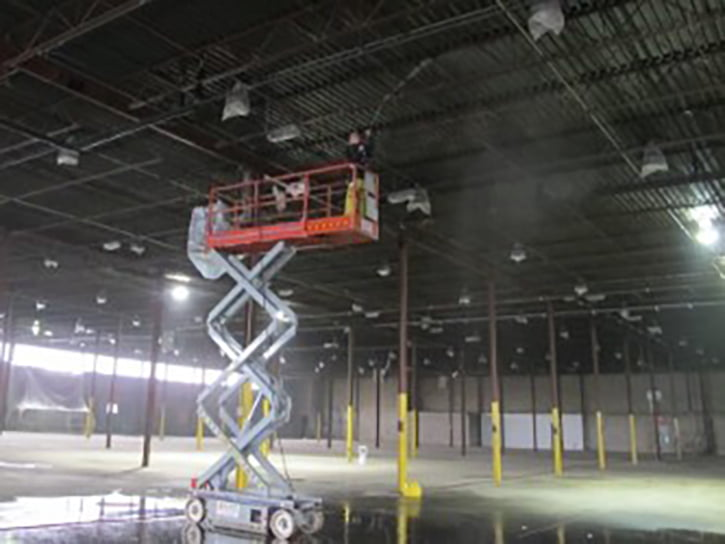Pressure Washing Warehouse Ceiling